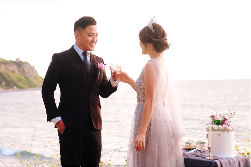bride and groom toast champagne at oceanside California elopement